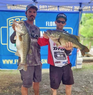 Joshua Dunn, left, and Sean Ripley had 25.16 pounds and also big bass with an 9.38 pounder to win first place during the Florida Bass Nation Central Region Team Trail tournament March 28 at Lake Kissimmee.