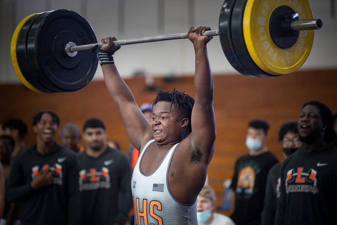 Lakeland High School Gee Milford makes a lift during the Class 3A, District 10 weightlifting meet at Winter Haven.