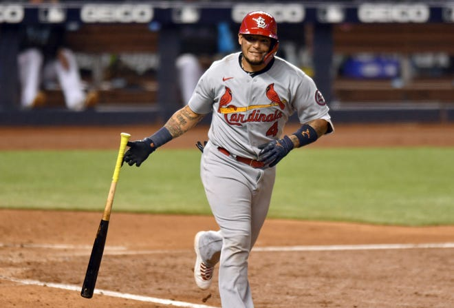 St. Louis Cardinals' Yadier Molina drops his bat after hitting a sacrifice fly during the sixth inning of the team's baseball game against the Miami Marlins, Tuesday, April 6, 2021, in Miami.