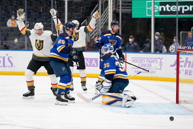 Vegas Golden Knights' Tomas Nosek, left, celebrates after scoring past St. Louis Blues goaltender Ville Husso (35) and Vince Dunn (29) during the first period of an NHL hockey game Monday, April 5, 2021, in St. Louis.