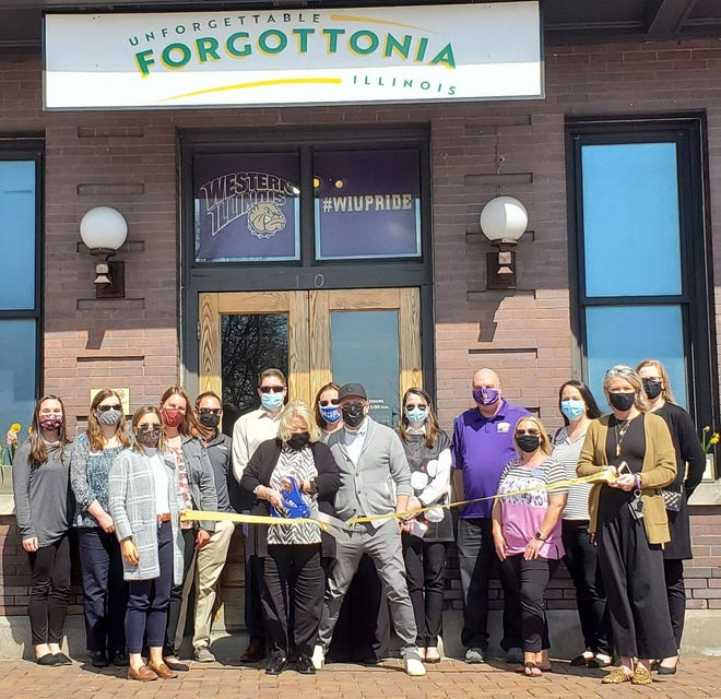 The Ambassador Committee of the Macomb Area Chamber of Commerce held a ribbon cutting for Unforgettable Forgottonia Illinois Macomb Area Convention & Visitors Bureau(MACVB), which recently relocated into the historic Macomb Amtrak Railway Station (120 E. Calhoun Street). The MACVB's mission is to offer services and activities for the leisure and business traveler with the goal of increasing awareness of events and attractions in the region to potential visitors. They are currently planning many exciting, upcoming Summer events; such as Heritage Days, The AKC Dog Show, Art Wind & Fire, and more. For information on the MACVB visit www.visitforgottonia.com.