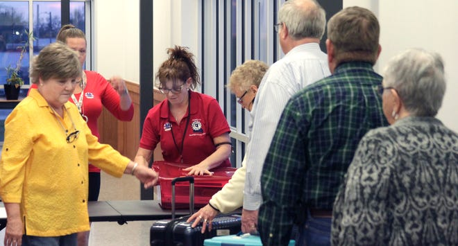 Randolph County Deputy Clerk Michelle Lee (red shirt) checks in documents and equipment Tuesday evening brought  to the clerk's office in Huntsville by volunteer election judges Tuesday evening that worked at one of the county precinct polling sites during the April 6 election.
