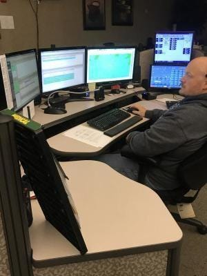 A dispatcher views records and data systems inside Monroe County Central Dispatch off S. Raisinville Rd., where all 911 emergency calls are received.
