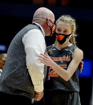 Summerfield senior Breanna Weston receives a hug from her coach Mickey Moody as she comes to the bench in the final seconds of the Division 4 state semifinals Wednesday. The Bulldogs fell 48-29 to Bellaire at Van Andel Arena in Grand Rapids.