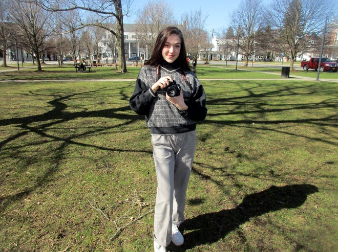 Abbygail Coston poses with her trusty camera April 3 on the Village Green in Hamilton. Coston has started her own photography business after attending the Young Entrepreneurs Academy program at Mohawk Valley Community College in Utica last year.