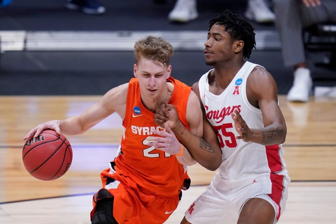 Syracuse forward Marek Dolezaj (21) played in 131 games for the Orange and started 83 times over four years.