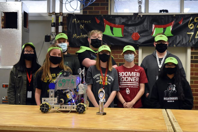 """The Mustang High School robotics team, nicknamed """"Monsters of Mechanics,"""" recently won the Think Award during the FIRST Tech Challenge Oklahoma Mars Qualifier event. Pictured left to right are Felicity Nguyen, Summer Schkolovyi, Cally Piland, Gabe Thele, Waverly Landrith, Camden Sayers, Jacob Thele and Lilly Nunez."""