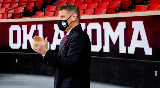 New OU men's basketball coach Porter Moser arrives or his introductory news conference at Lloyd Noble Center in Norman.