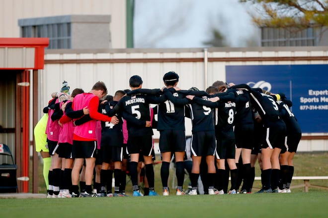 Mustang players huddle before a home game against U.S Grant on April 6. The Broncos are ranked second in the country in the latest United Soccer Coaches poll.