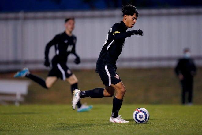 Mustang's Isaias Silva runs up field during the high school boys soccer game between Mustangs and U.S Grant at Mustang High School in Mustang, Okla., Tuesday, April 6, 2021.