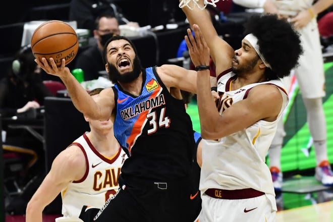Thunder guard Kenrich Williams (34) drives to the basket against Cavaliers center Jarrett Allen (31) during a game on Feb. 21 in Cleveland.