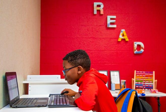 Roman Cash, 9, uses the virtual learning area inside Recess OKC in Oklahoma City.