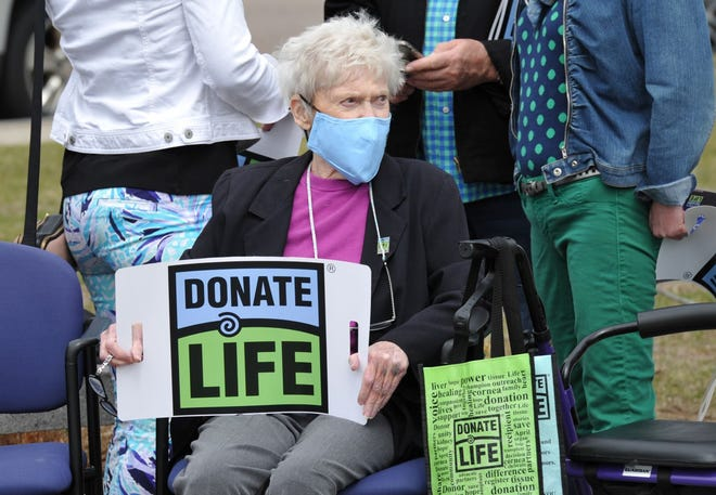 Lois Murphy of Braintree, whose grandson Lucas Flint was an organ donor, listens to remarks during the Donate Life Month celebration at Braintree Town Hall, Wednesday, April 7, 2021. Tom Gorman/For The Patriot Ledger