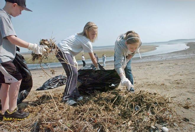 Volunteers pick up debris on Merrymount Beach in 2011.