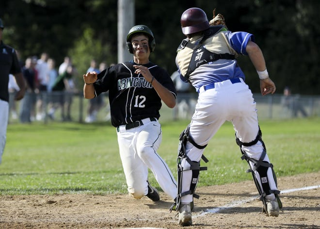Abington's John Hawkesworth slides to home plate but it tagged out by St. John Paul's catcher Will Good in the 2019 Division 4 South Sectional finals.