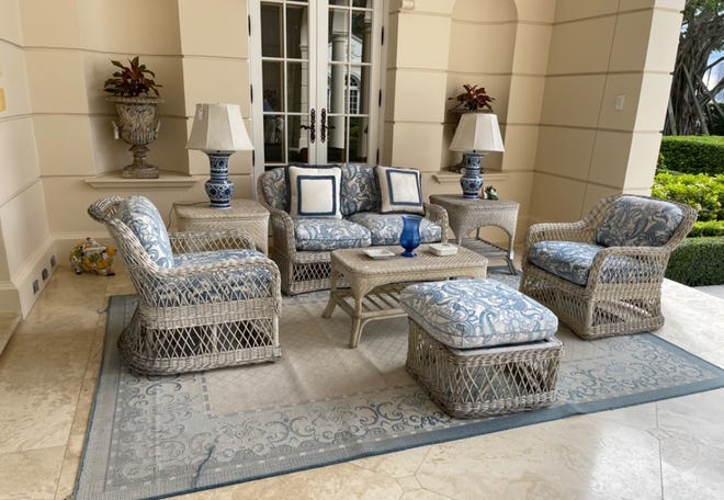 An wicker outdoor seating group with Chinese-style lamps were part of a loggia at the Palm Beach estate of the late Kathleen Ford. They will be among the items on the bidding block this weekend in a sale organized by the Kaminsky auction house.