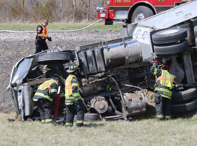 Members of the Pontiac Fire Department work at securing the semi-tractor-trailer before extricating the driver after an accident on Old Route 66 near Aurora Avenue Wednesday. There were no report provided by deadline.