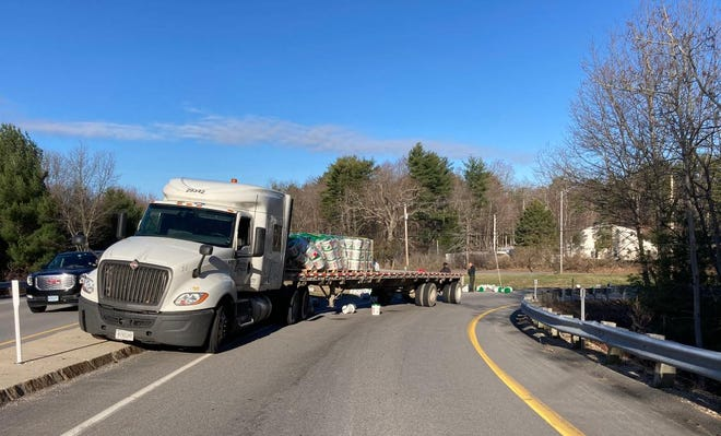 The Route 1 and Route 101 interchange was shut down for several hours Wednesday morning after a tractor trailer spilled its cargo.