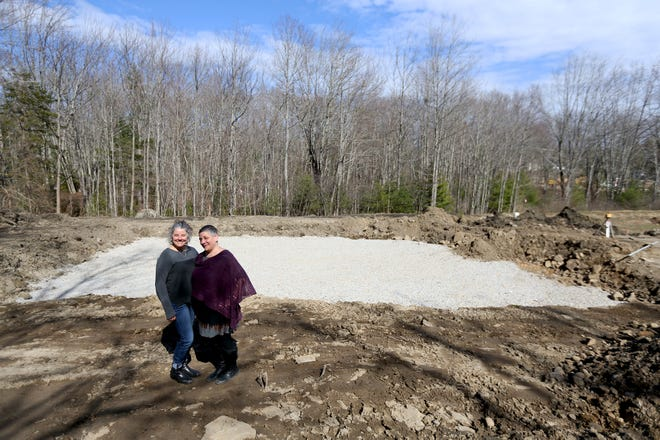 Jennifer Armstrong, left, and Tanya Alsberg, right, are future homeowners of a two-story house to be built in Kennebunkport, Maine, this year as part of the Kennebunkport Heritage Housing Trust's effort to make affordable houses available.