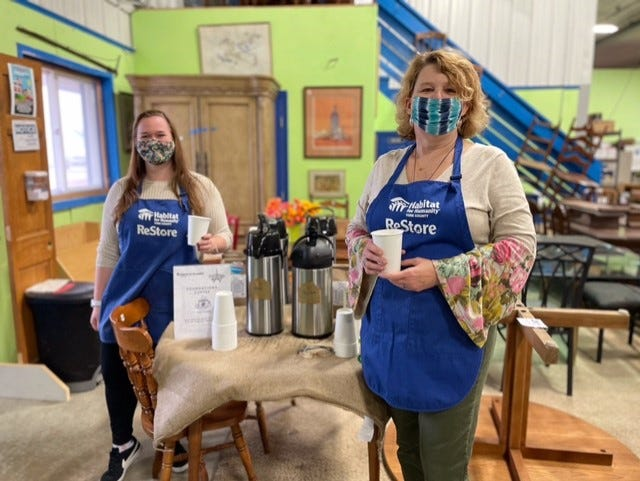 Alana Shapiro, left, and Michelle Robinson, hold cups of the new Foundations Blend coffee at Habitat for Humanity of York County's Restore in Kennebunk, Maine. Mornings in Paris is offering the blend as a fundraiser for the organization, which builds affordable homes for families.