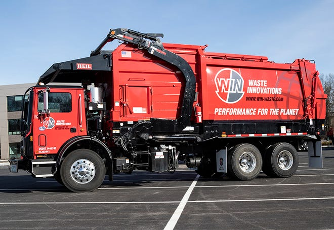 A Waste Innovations front loader truck displays the new company's branding. Wheelabrator Technologies Inc.announced the integration of 10 leading waste industry businesses into a single company operating under the WIN Waste Innovations brand name.