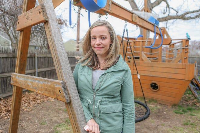 Ali Smith in her Pawtucket backyard. She would like to opt out of state standardize testing of her twin boys, and there are many Rhode Island parents who feel the same way about their kids.