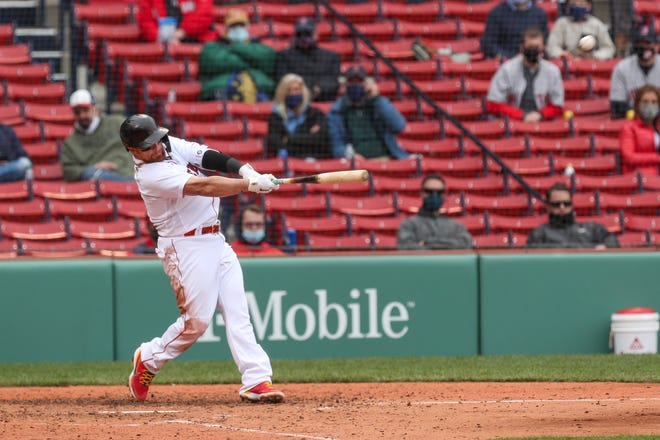 Christian Vazquez hits a home run in the fourth inning against the Tampa Bay Rays on Wednesday afternoon at Fenway Park.
