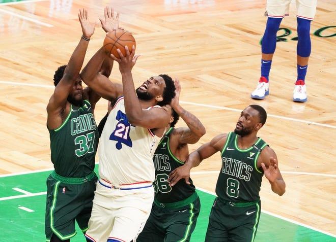 Apr 6, 2021; Boston, Massachusetts, USA; Philadelphia 76ers center Joel Embiid (21) shoots against Boston Celtics forward Semi Ojeleye (37) and Boston Celtics guard Marcus Smart (36) in the fourth quarter at TD Garden. Mandatory Credit: David Butler II-USA TODAY Sports