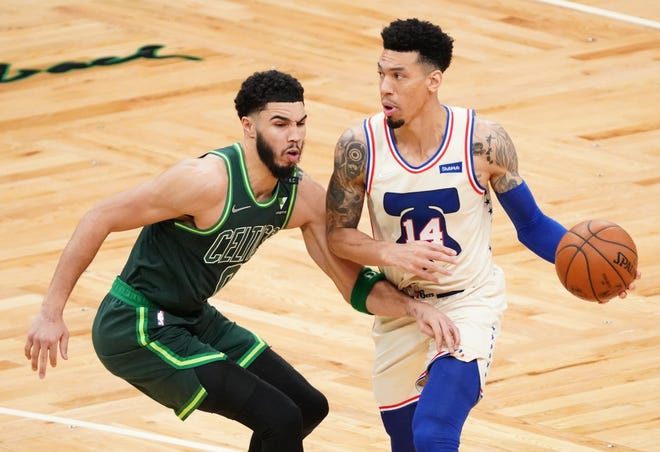 Philadelphia 76ers forward Danny Green tries to drive against Celtics forward Jayson Tatum during the fourth quarter Tuesday night at TD Garden.