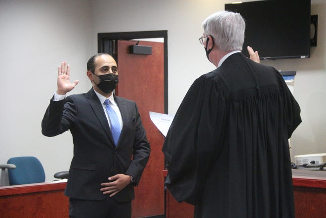 Abdul Odeh is sworn in as an attorney by Judge Kenneth Pritchard April 1 in Ridgecrest.