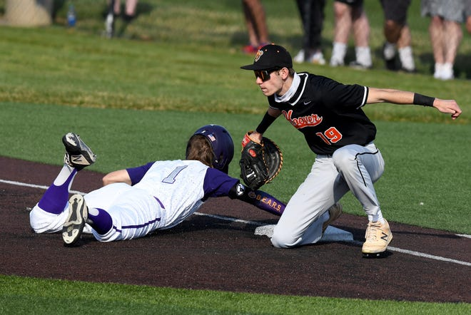 Gus Holben of Hoover tags out Calvin Casper of Jackson at first base after a pick-off throw from Hoover pitcher Owen Blackledge in the second inning at Jackson, Tuesday , April 6, 2021.
