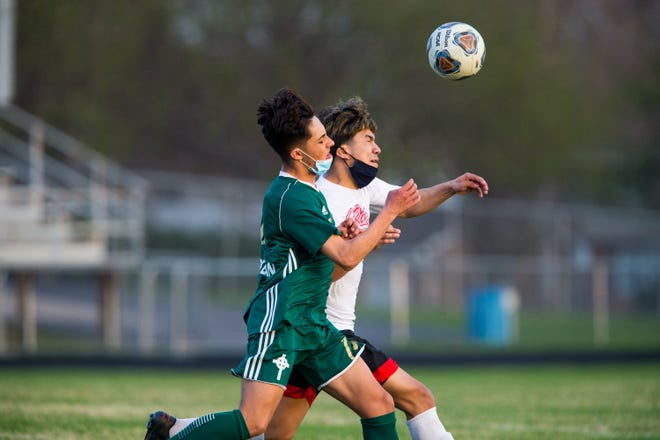 Boylan's Victor Ibarra, in green, and East's Diego Medina, shown fighting for the ball in Boylan's April 6 win, were both named first-team all-conference in NIC-10 boys soccer for the 2021 spring season.