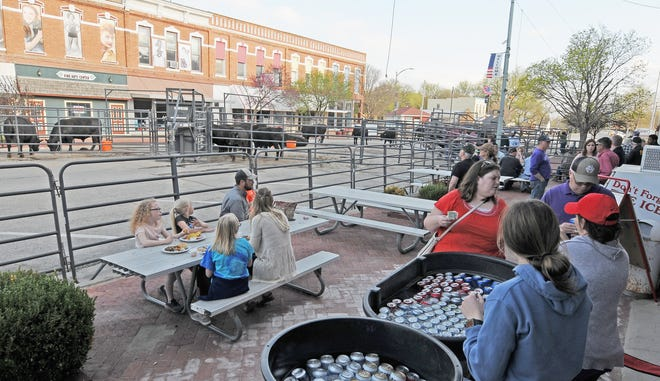 "The Ranch House, 109 N. Washington St., sold cold beverages and provided additional outside seating during the Barta Farms ""Angus Comes to Town"" bull sale in downtown Marquette on Tuesday evening."