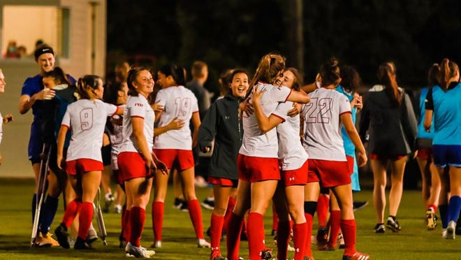 Members of the Flagler College women's soccer team celebrate their 2-1 victory over UNC Pembroke on Tuesday night in a semifinal of the Peach Belt Conference tournament at Flagler. April 6, 2021.