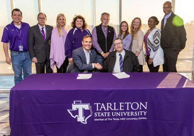 Tarleton President James Hurley and Ranger College President William Campion seal the deal to provide annual scholarships to Ranger College students who transfer to Tarleton.