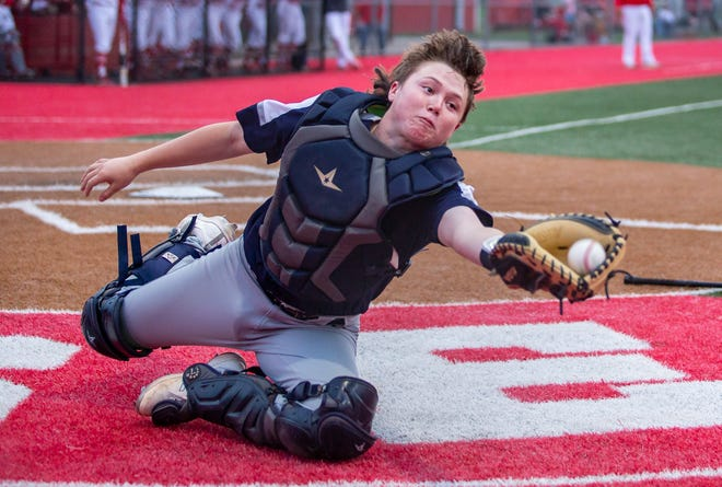 Stephenville catcher Cutter Gray drive to haul in a foul bunt attempt in the Yellowjackets' 12-5 win over Glen Rose on Tuesday night.