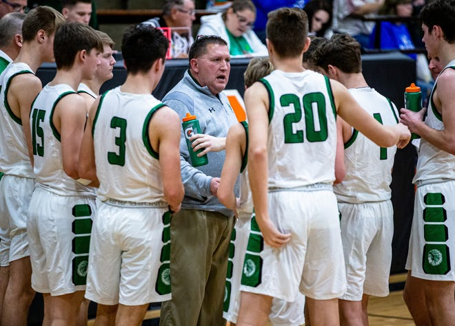 Athens boys basketball head coach Jeff Johnston talks with his players in a timeout as they take on North Greene in the second half during the 69th annual Waverly Holiday Tournament in 2019.