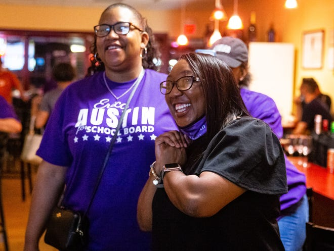 Erica Austin, right, along with her cousin Rena Naudain, left, reacts as she watches the early numbers come in for her election bid for Subdistrict 6 of the Springfield School Board in the consolidated election at a small get together of supporters at It's All About Wine in Springfield, Ill., Tuesday, April 6, 2021.