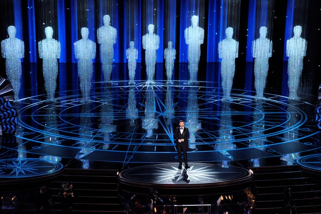 FILE - In this Feb. 26, 2017 file photo, host Jimmy Kimmel speaks at the Oscars in Los Angeles. Some people watch awards shows out of love, others because they love to hate. But this year, as ratings have taken a dive, will anybody tune in to the Oscars? Pushed by the pandemic from its usual berth of February or early March, the Academy Awards will be presented April 25 on ABC.  (Photo by Chris Pizzello/Invision/AP, File)