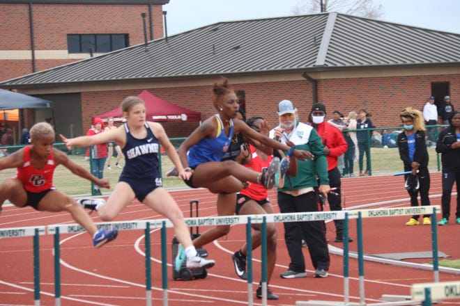 Shawnee's Madison Crowell (second from left) clears a hurdle on her way to a third-place finish in the girls' 100 hurdles Tuesday at Oklahoma Baptist University.