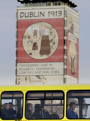 Workers make their way home from work on a bus in Dublin city centre, Ireland in 2013.  (AP Photo/Peter Morrison)