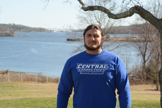 Kolt MacCracken, shown in his Montville backyard along the Thames River, is continuing his football journey at Central Connecticut State University this fall.