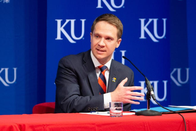 The University of Kansas' new athletic director Travis Goff answers questions during a news conference Wednesday at the Lied Center in Lawrence. A Dodge City native, Goff in 2002 graduated from KU with degrees in journalism and sociology.