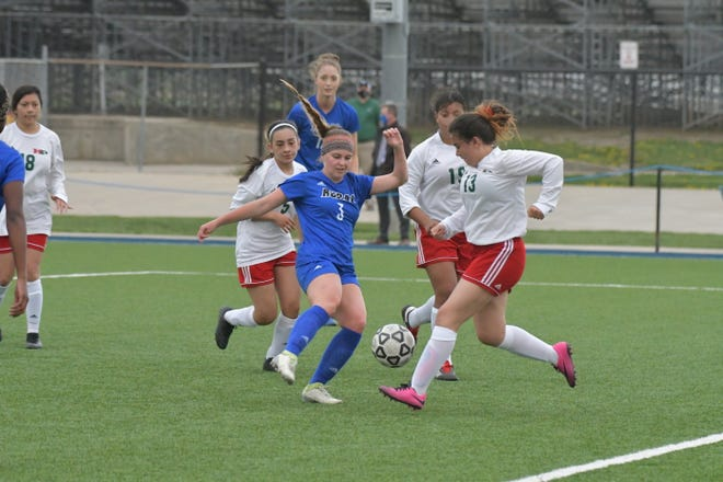Washburn Rural's Izzy Entz (3) tries to maneuver past Highland Park's Lizbeth Del Real (13) and two other Scot players during Tuesday's game. Entz had a goal as Rural won 10-0.