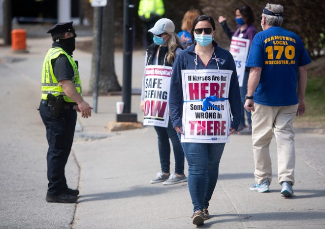 Nurse Paola Marble walks a picket line out St. Vincent Hospital in Worcester.