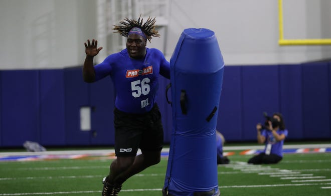 "Florida defensive lineman Tedarrell ""TJ"" Slaton works during a drill at Florida Pro Day on campus last week."