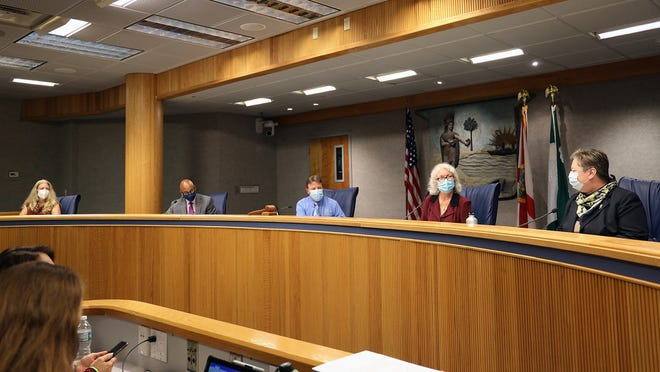 Members of the Alachua County Commission meet.