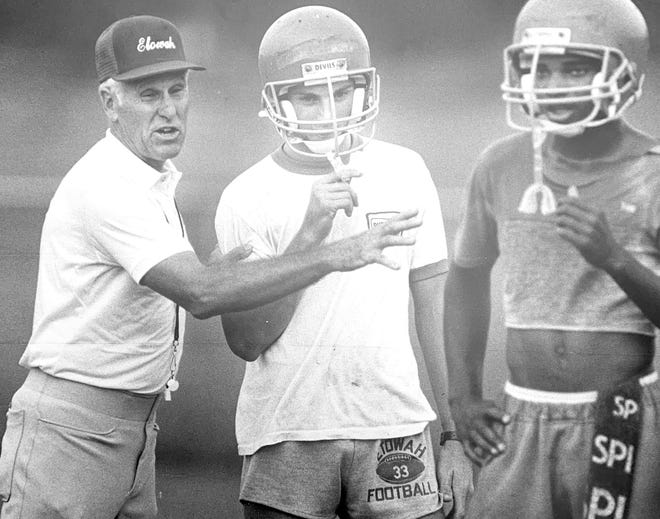 Excell Hester instructs Etowah High players in 1987 after returning to his alma mater as an assistant coach. Hester, one of the Blue Devils' greatest athletes, died Sunday at 93.