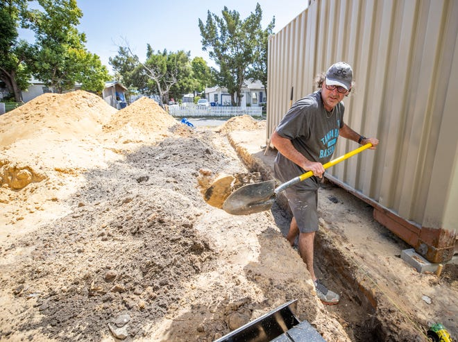 Alan Donalson, owner of Donalson Contracting LLC is on the verge of having to close because of a lack of employees. He has taken on some of the manual labor, like digging ditches, to keep his company afloat.