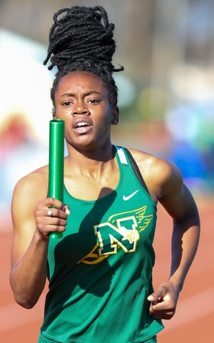 Northland junior Nasia Bailey runs the first leg of the 1,600 relay during the Northland Relays on March 27. The Vikings girls team will be trying to capture a fifth consecutive City League championship.